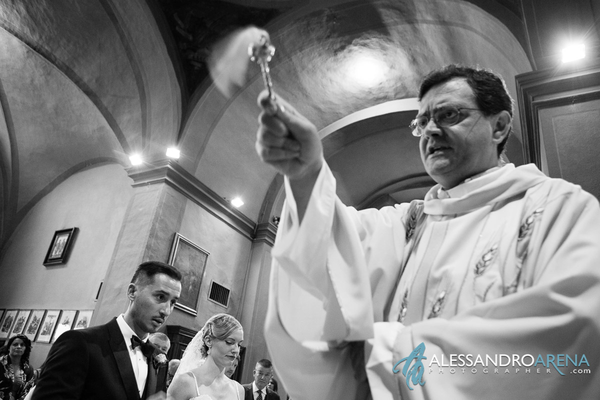 Blessing of the priest - Italian wedding ceremony lombardy