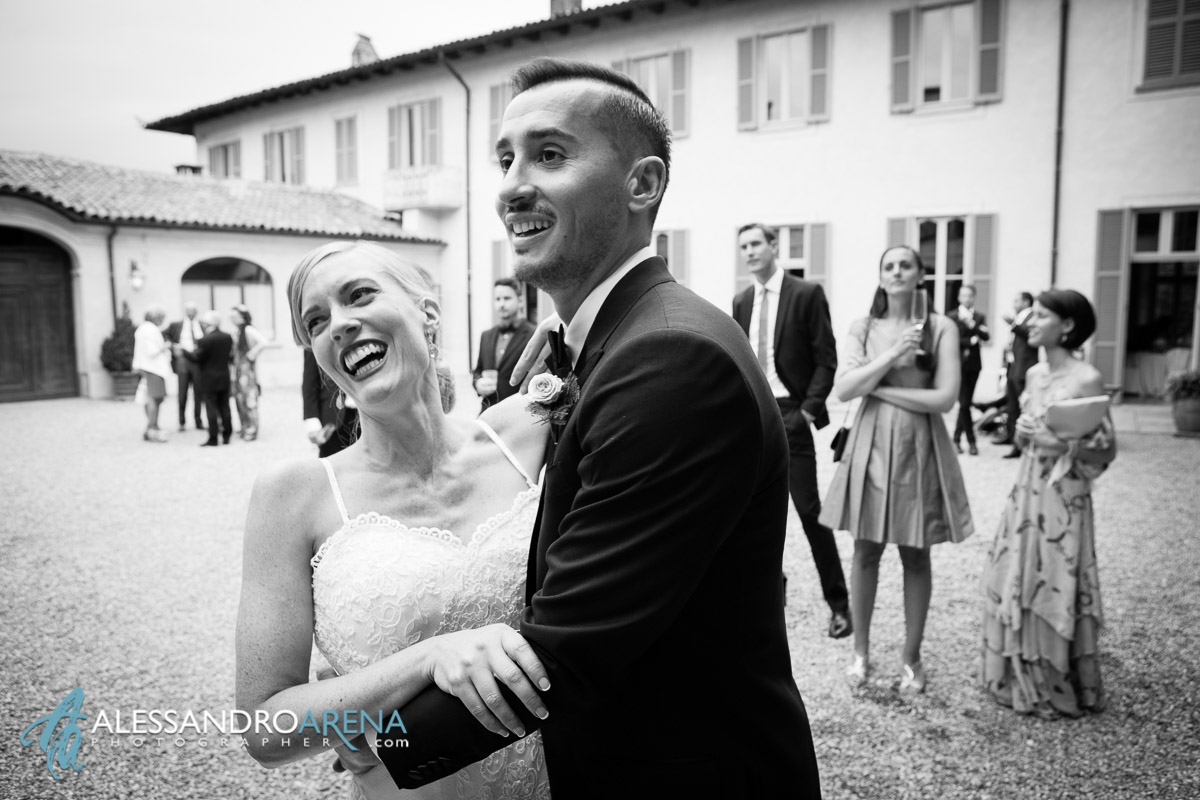 The bride and the groom are having fun with their guest - Villa Bossi wedding Reception in Italy