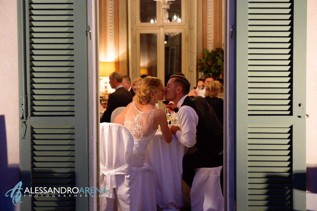 Kiss for bride and groom - Villa Bossi wedding reception Varese, Lombardy