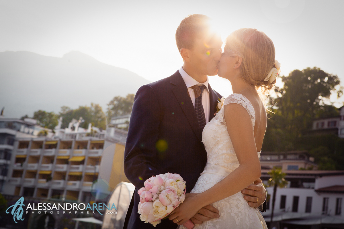 Wedding portraits in lake Maggiore Ascona - Bride and groom kiss